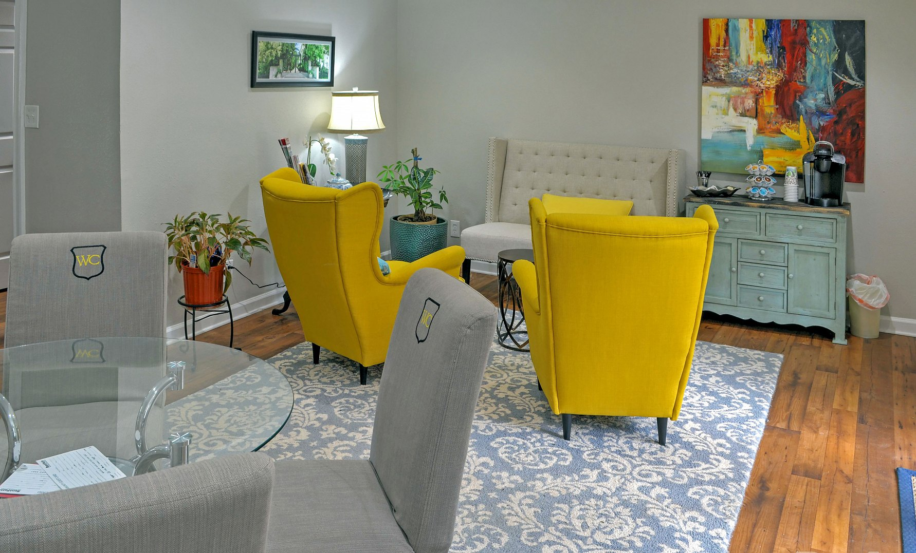 living room with beautiful yellow sofas